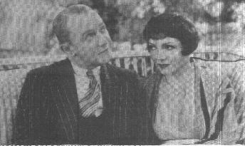 George M. Cohan and Claudette Colbert